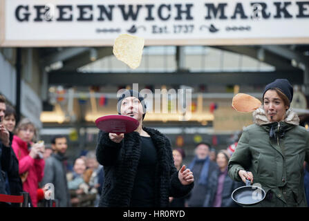 London, UK. 25th Feb, 2017. People take part in an annual Greenwich Market pancake warmup race, named the Big Flippin' - Stock Photo