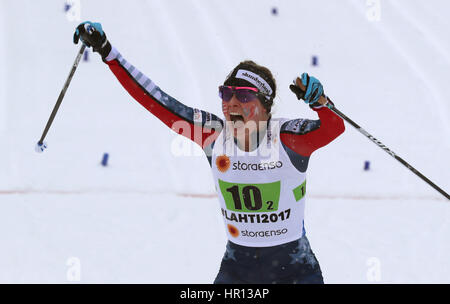 Lahti, Finland. 26th Feb, 2017. Jessica Diggins from the US celebrates after the women's classic cross-country team - Stock Photo