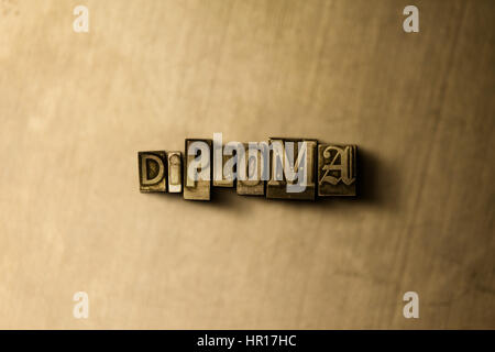 DIPLOMA - close-up of grungy vintage typeset word on metal backdrop. Royalty free stock - 3D rendered stock image. - Stock Photo