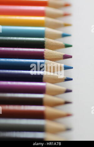 Row of colored pencils in shallow focus - Stock Photo