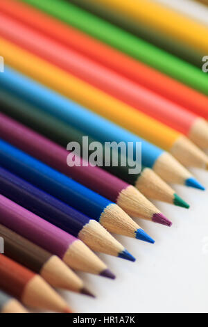Diagonal row of colored pencils close up - Stock Photo