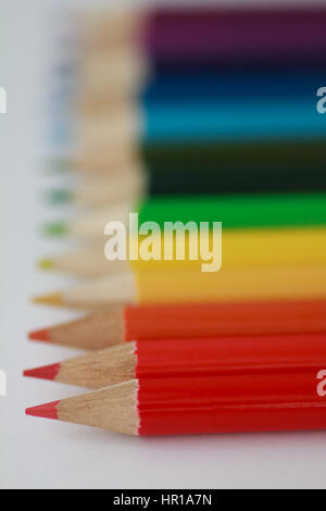 Shallow focus colored pencils with red pencil in sharp focus - Stock Photo