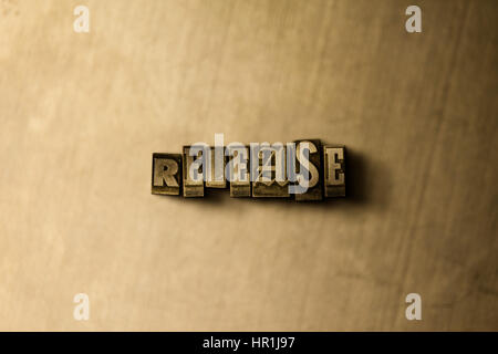 RELEASE - close-up of grungy vintage typeset word on metal backdrop. Royalty free stock - 3D rendered stock image. - Stock Photo