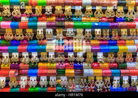 Colourful Indian bangles, earrings and jewellery on display - Stock Photo