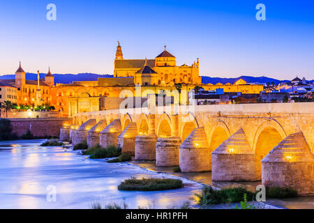 Cordoba, Spain, Andalusia. Roman Bridge on Guadalquivir river and The Great Mosque (Mezquita Cathedral) - Stock Photo