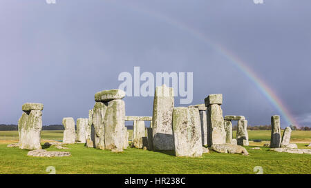 Stonehenge, prehistoric monument of standing stones, set against a foreboding blue sunny sky in winter at Amesbury, - Stock Photo
