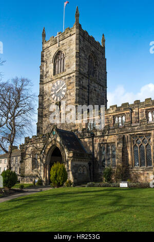 Clock tower and entrance of Holy Trinity Church Skipton North Yorkshire England - Stock Photo