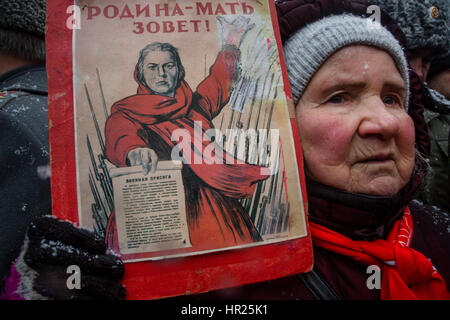 A supporter participates in a march marking the 99th anniversary of the establishment Soviet Army and Navy on Defender - Stock Photo