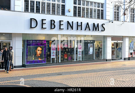 Chelmsford Debenhams department store entrance & shop front window display in paved shopping retail high street - Stock Photo