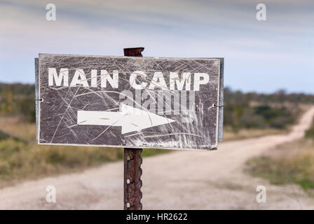 Worn out sign pointing to main safari camp. Kruger National Park, South Africa - Stock Photo
