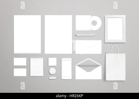 Stationery on desk. Blank white items for mockup. Top view. - Stock Photo