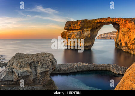 Gozo, Malta - Sunset at the beautiful Azure Window, a natural arch and famous landmark on the island of Gozo - Stock Photo