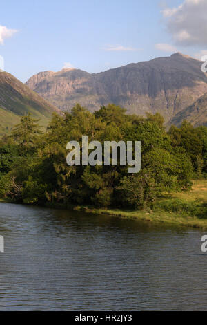 Glencoe Mountains. Photo from Bridge with River, Mountains, Trees and Blue Sky. Landscape Lochs and Scenery in Scottish - Stock Photo