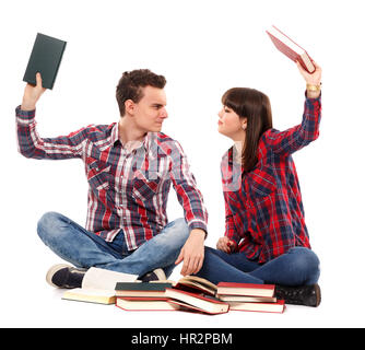 Argument between two teenagers while studying, on white background - Stock Photo