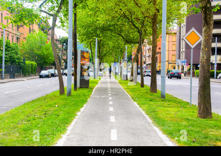 Bologna traffic, Italy, 17 April 2016 - bicycle lane in the middle of the ring road of Bologna, best know as Viali - Stock Photo