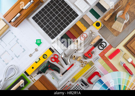 Home renovation and do it yourself concept with home construction and  repair tools on wooden surface. Do It Yourself  Home Renovation And Construction Concept With Diy