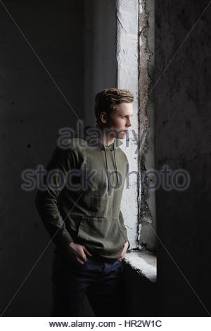 Moody young man in a hoodie - Stock Photo