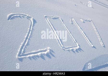 new years date 2017 written in fresh powder snow - Stock Photo