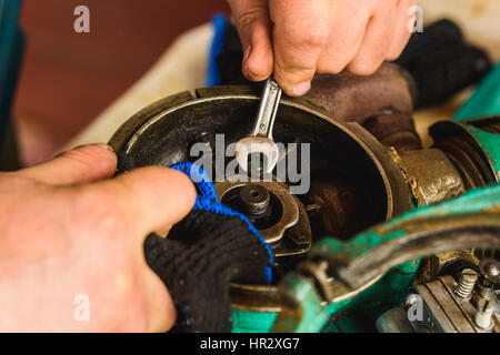 Rusty adjustable wrench and bolt on wheel tractors - Stock Photo