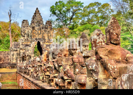Guardians at the South Gate of Angkor Thom - Siem Reap, Cambodia - Stock Photo