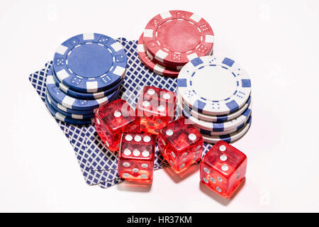 Gambling devices used in many games of chance cards, casino dice and betting tokens - Stock Photo
