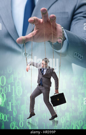 Businessman puppet being manipulated by boss - Stock Photo