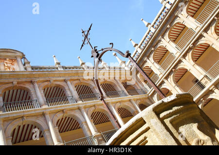 Courtyard of The University of Alcala (originally founded in 1293), Alcala de Henares, Spain. Focus on the cross! - Stock Photo