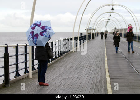 Southport, Merseyside, UK.  Weather.  27th February, 2017. Cold, Wet and Windy for people walking on Southport's - Stock Photo