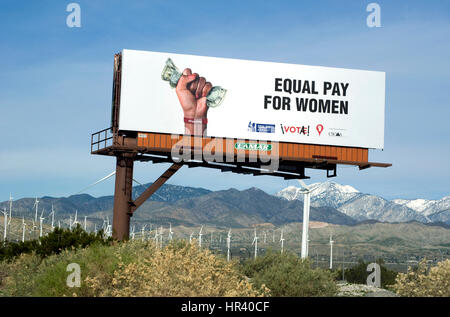Billboard supporting equal pay for women in the desert near Palm Springs - Stock Photo