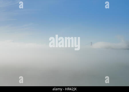 San Francisco's Golden Gate Bridge Partially Obscured By Sea Fog. - Stock Photo