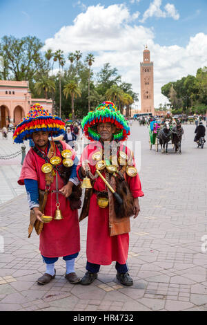 Marrakesh, Morocco.  Two Water Sellers (Guerrab) in the Place Jemaa El-Fna. - Stock Photo