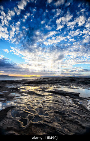 Spectacular mackerel sky at sunset at Gerroa, New South Wales, Australia - Stock Photo