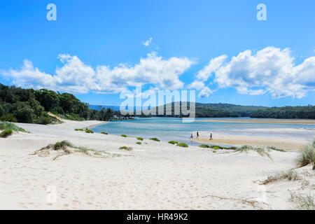 People walking in the shallow waters of Lake Conjola, Shoalhaven, South Coast, New South Wales, NSW, Australia - Stock Photo
