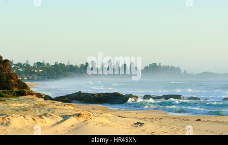Sea spray early in the morning at Potato Point, New South Wales, Australia - Stock Photo