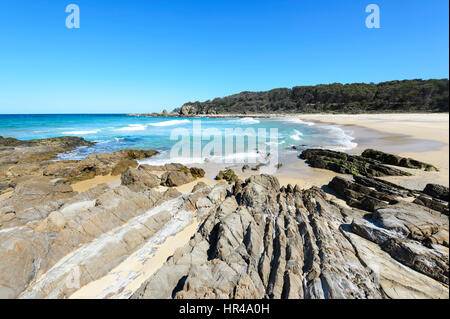 Deserted sandy beach with amazing rock formations at Potato Point, New South Wales, Australia - Stock Photo