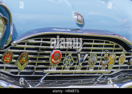 Vauxhall Vintage Car - close-up of highly polished front grille with Vauxhall logo and grille badges - Stock Photo