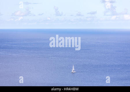 large sail boat in caribbean sea off the coast of St Bart's - Stock Photo
