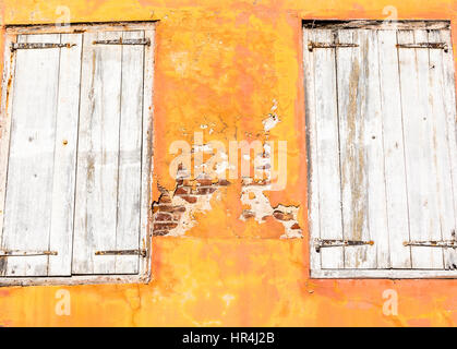 very old shutters on an old St Bart's building in Gustavia - Stock Photo
