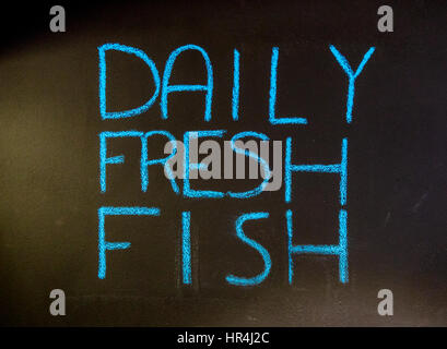 Daily Fresh Fish sign written in chalk on a chalk board in St Barts - Stock Photo