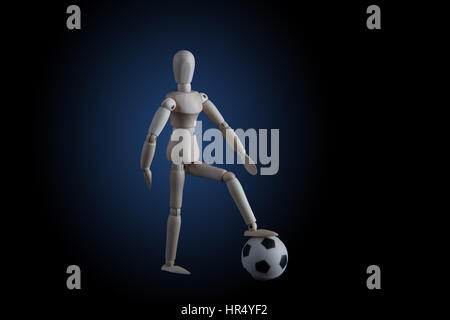 Wooden figurine stepping on soccer ball on black background with blue spotlight. Soccer game player concept - Stock Photo