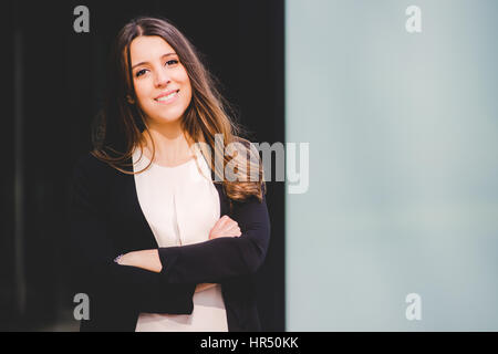 young authentic business woman in the city for a buisness trip - Stock Photo