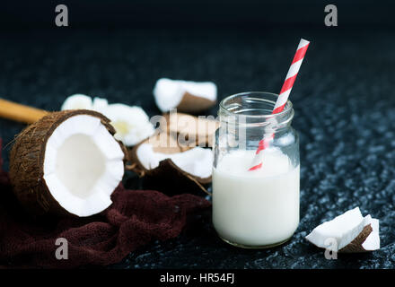 coconut products on a table, coconut milk and butter - Stock Photo