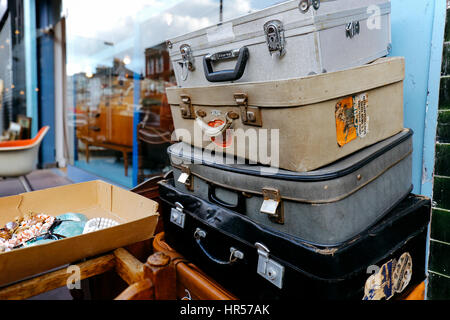 Stack of vintage suitcases with stickers on sale in Chatsworth Road Market. The market has a long heritage and is - Stock Photo