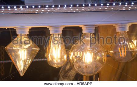 Decorative antique edison style filament light bulbs hanging - Stock Photo