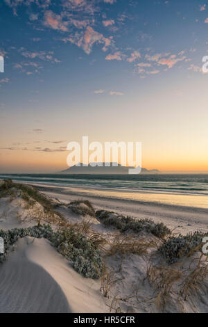 View of Table Mountain at Sunset from Big Bay, Bloubergstrand, Cape Town, South Africa - Stock Photo