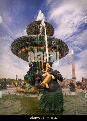 Fountain on Place de la Concorde in Paris, France. The Luxor Obelisk is in the background. - Stock Photo
