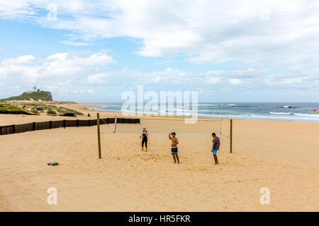 Playing beach volleyball on Nobbys Beach,Newcastle i new south wales,australia - Stock Photo