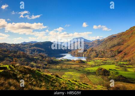 View along Nantgwynant valley to Llyn Gwynant lake in mountains of Snowdonia National Park in autumn. Nant Gwynant, Gwynedd, North Wales, UK, Britain