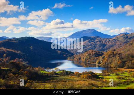 View along valley to Llyn Gwynant lake and distant Yr Aran mountain in Snowdonia National Park (Eryri) in autumn. Nant Gwynant Gwynedd North Wales UK