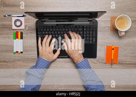 Male hand typing on laptop, message Empty text field - Stock Photo